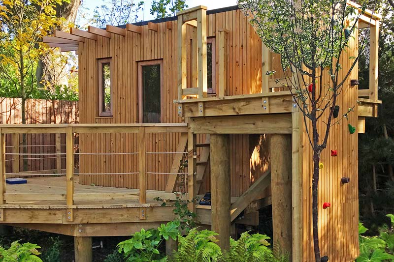 Bespoke contemporary treehouse with zipline tower, rope bridge and climbing wall