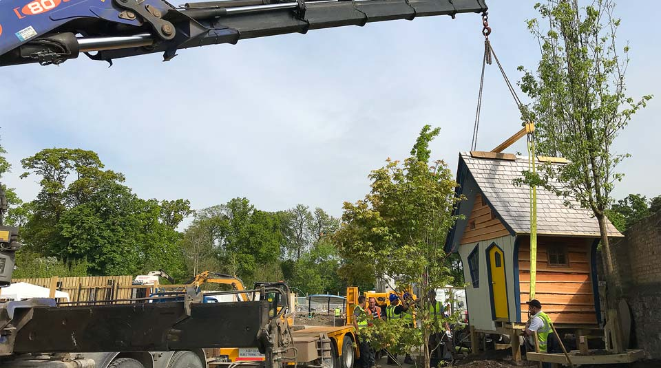 A crane lifts the prefabricated treehouse into place in Bloom 2018